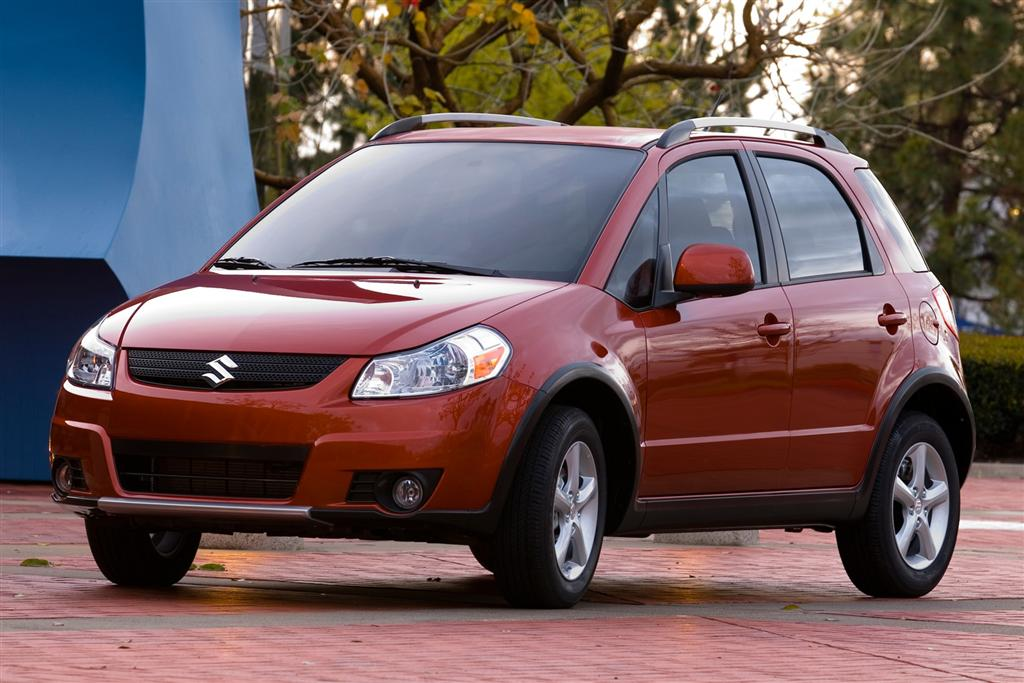 Red suzuki SX4 2009 photo