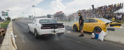 DODGE DRAWS TENS OF THOUSANDS TO THE FIRST-EVER LEGAL STREET DRAG RACING ON WOODWARD AVE WITH ROADKILL NIGHTS FESTIVAL .
