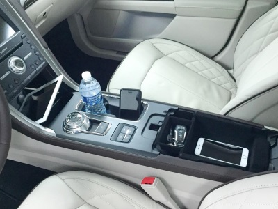 AMERICANS CARRY AROUND SO MANY ELECTRONIC DEVICES THAT FORD HAD TO RETHINK THE CAR INTERIOR
