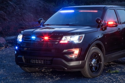 FORD POLICE INTERCEPTOR UTILITY DEBUTS REAR SPOILER TRAFFIC WARNING LIGHTS TO COMPLEMENT FRONT INTERIOR VISOR LIGHT BAR