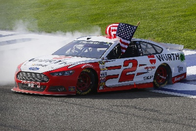 BRAD KESELOWSKI WINS NASCAR SPRINT CUP SERIES RACE IN DRAMATIC FASHION WITH LAST-LAP PASS OF HARVICK AND BUSCH