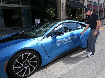 RORY MCILROY TAKES A DIFFERENT KIND OF DRIVE IN THE ALL-NEW BMW I8 DURING THE 2014 BMW CHAMPIONSHIP