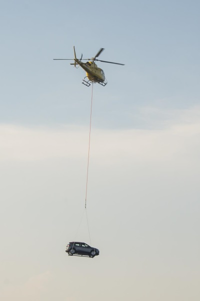 This Is How You Hang A Car From A Helicopter
