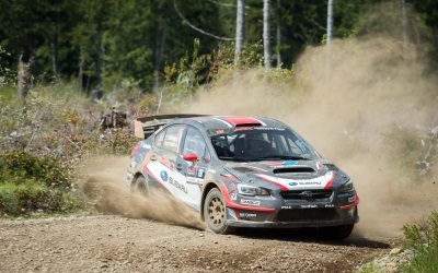 Subaru Rally Team USA Drivers David Higgins And Travis Pastrana Top Olympus Rally Podium