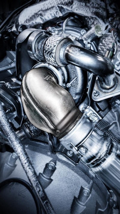 HOW A TURBOCHARGER EXHAUST PIPE SHAPED LIKE A COBRA HEAD HELPS FORD POWER STROKE DIESEL MAKE BEST-IN-CLASS POWER