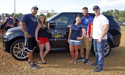 WWE SUPERSTAR JOHN CENA GIVES INVICTUS GAMES COMPETITORS A RIDE TO REMEMBER AS JAGUAR LAND ROVER SURPRISE CHAUFFEUR
