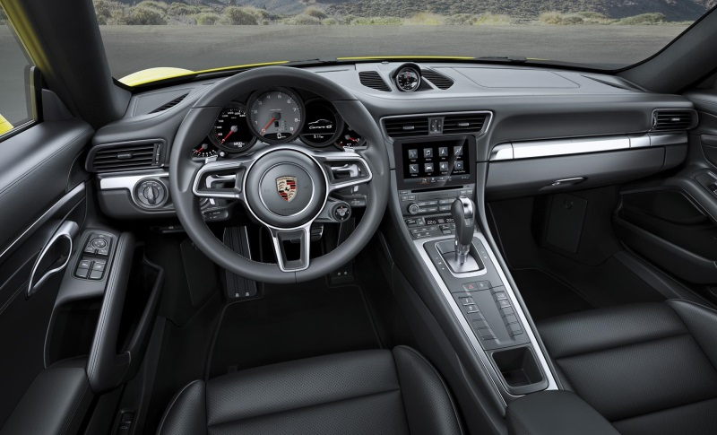 THE PORSCHE 911 CARRERA 4 AND 911 TARGA 4 MODELS WITH NEW TURBOCHARGED ENGINES AND ENHANCED ALL-WHEEL DRIVE SYSTEMS